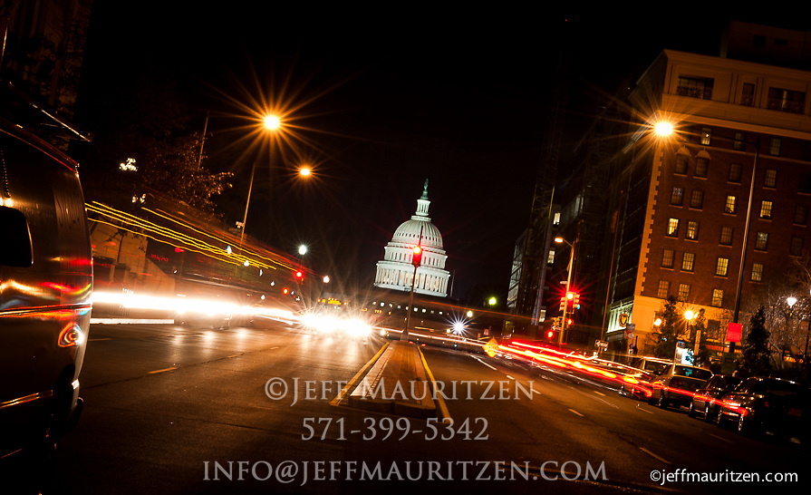Image of the US Capitol Building at Night.