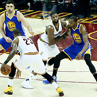 09 June 2017: Cleveland Cavaliers forward LeBron James (23) drives past Golden State Warriors forward Kevin Durant (35) on a screen set by Cleveland Cavaliers center Tristan Thompson (13) during the Cleveland Cavaliers 137-11 victory over the Golden State Warriors, in game 4 of the 2017 NBA Finals, at  the Quicken Loans Arena, Cleveland, Ohio, USA.