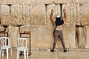 Wailing Wall, Jerusalem old city, Israel Man at prayer