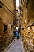 Morocco. The medina in Fes, Fes el Bali, is on UNESCO's World Heritage Site list. A very narrow street.