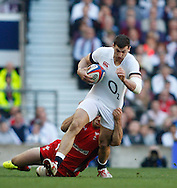 Jonny May of England in action during the RBS 6 Nations match at Twickenham Stadium, Twickenham<br /> Picture by Andrew Tobin/Focus Images Ltd +44 7710 761829<br /> 09/03/2014