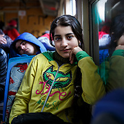 """Maram, 13, a refugee from Daraa, Syria, takes the train with her family from Presevo, Serbia, to the Croatian border. From there, they will continue on to Germany. """"The people in Greece were so nice to us, but the journey has been very exhausting, and the boats were very scary. Now we are going to Germany, and we will study and learn the language. And we will stay there and hope for a happy life."""" January 2016. Produced for Mercy Corps."""