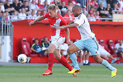 20.07.2013, Coface Arena, Mainz, GER, Testspiel, 1. FSV Mainz 05 vs West Ham United, im Bild Winston Reid (West Ham United WHUFC) attakiert Sebastian Polter (Mainz) und foult ihn zum Elfmeter,,  // during the Friendly Match between 1. FSV Mainz 05 and West Ham United at the Coface Arena, Mainz, Germany on 2013/07/20. EXPA Pictures © 2013, PhotoCredit: EXPA/ Eibner/ Bildpressehaus<br /> <br /> ***** ATTENTION - OUT OF GER *****