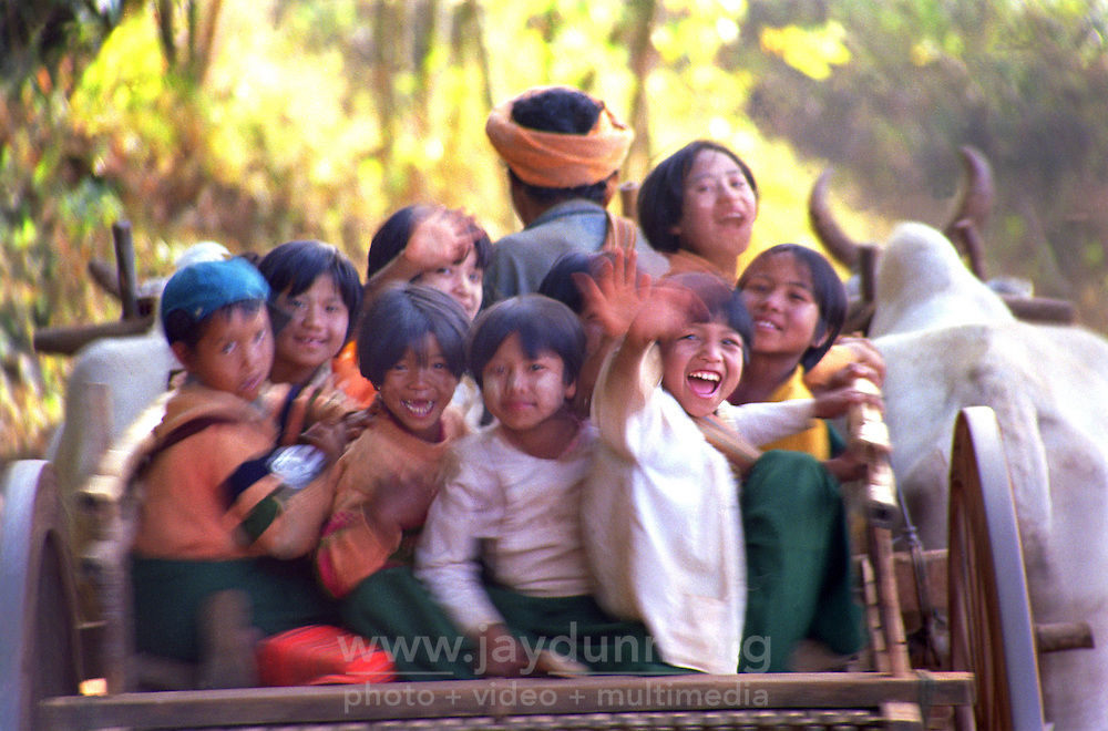 BURMA (MYANMAR) Shan State, Kalaw. 2006. : Friendly, curious and hard-working, these Pa-O students are on their way to school. A teacher in a village like this might make ten US dollars a month.