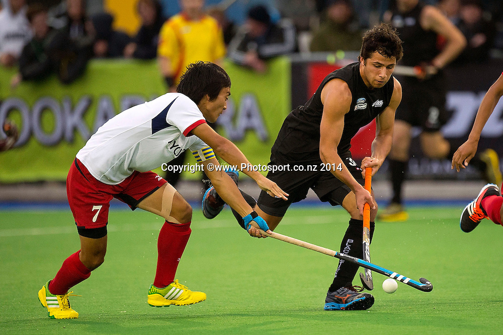 George Muir (R of New Zealand is tackled by Tomonori Ono of Japan during the Black Sticks Men v Japan international hockey match at the Coastlands Kapiti Sports Turf in Paraparaumu on Friday the 21st of November 2014. Photo by Marty Melville/www.Photosport.co.nz