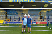 AFC Wimbledon manager Wally Downes in front of the Chemflow end wearing a hard hat during the Pre-Season Friendly match between AFC Wimbledon and Brentford at the Cherry Red Records Stadium, Kingston, England on 5 July 2019.