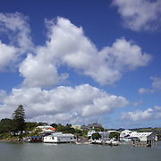A view of Rawene from the car ferry. Rawene is a town on the south side of the Hokianga harbour, in Northland,  A car ferry links it to Kohukohu and the northern Hokianga. Rawene started as a timber centre, with a mill and shipyards established in the early 19th century.  Rawene, Northland, New Zealand. 22nd November 2011.  Photo Tim Clayton.