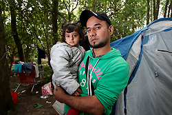 FRANCE GRANDE SYNTHE 2AUG17 - Iraqi Kurd Marding Sokolom, 30, and his daughter Aya, 3 stand on front of  their damaged tent in the unofficial Jungle II camp near Grande Synthe, Dunkirk, northern France.<br /> <br /> He claims to have relatives living in the UK and has been at the camp for nearly one month. They have travelled for 6 months to get here, including a 6-day boat ride across the Mediterranean with 100 fellow refugees - a journey during which all thought they would drown. <br /> <br /> jre/Photo by Jiri Rezac<br /> <br /> © Jiri Rezac 2017