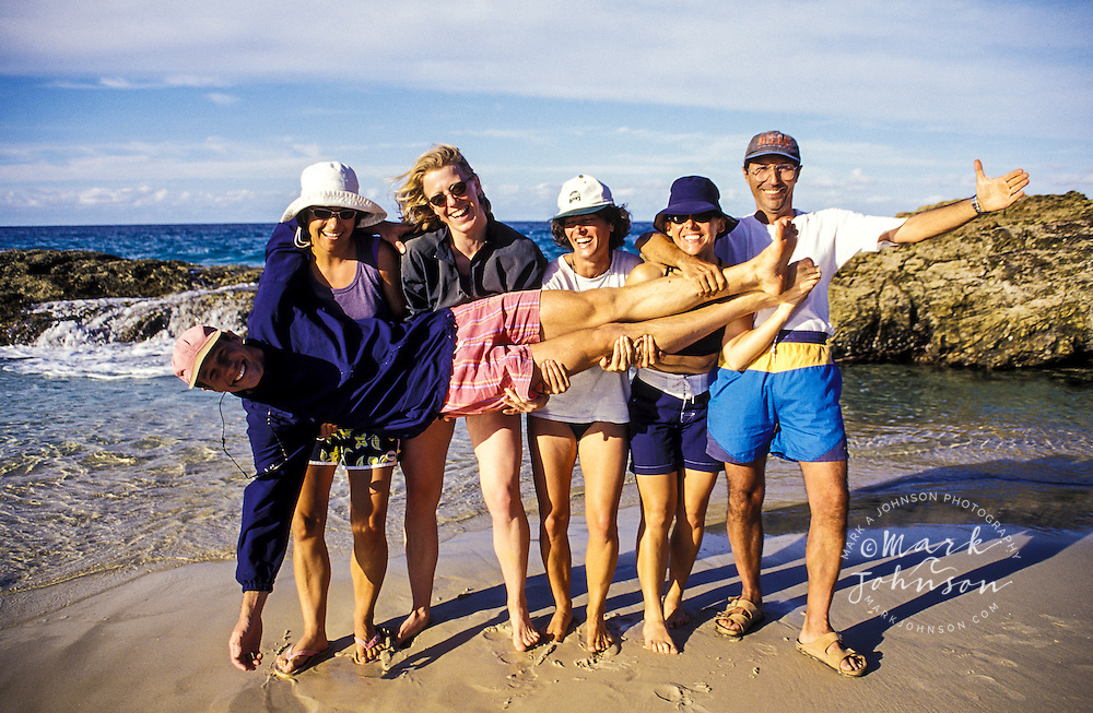 Australia, Queensland, Moreton Island, friends having fun on beach.  MR available