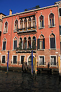 Architecture along the Grand Canal shows typical Venetian style windows, Venice, Italy...Subject photograph(s) are copyright Edward McCain. All rights are reserved except those specifically granted by Edward McCain in writing prior to publication...McCain Photography.211 S 4th Avenue.Tucson, AZ 85701-2103.(520) 623-1998.mobile: (520) 990-0999.fax: (520) 623-1190.http://www.mccainphoto.com.edward@mccainphoto.com..edward@mccainphoto.com