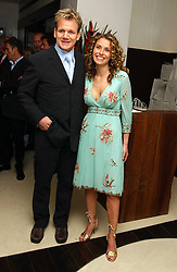 Top chef GORDON RAMSAY and his wife TANA at a party to celebrate the opening of Maze - a new Gordon Ramsay restaurant at 10-13 Grosvenor Square, London W1 on 24th May 2005.<br />