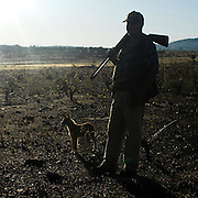 Hunter in Badajoz province, Extremadura region, Spain . The WAY OF SAINT JAMES or CAMINO DE SANTIAGO following the Silver Way, between Seville and Astorga, SPAIN. Tradition says that the body and head of St. James, after his execution circa. 44 AD, was taken by boat from Jerusalem to Santiago de Compostela. The Cathedral built to keep the remains has long been regarded as important as Rome and Jerusalem in terms of Christian religious significance, a site worthy to be a pilgrimage destination for over a thousand years. In addition to people undertaking a religious pilgrimage, there are many travellers and hikers who nowadays walk the route for non-religious reasons: travel, sport, or simply the challenge of weeks of walking in a foreign land. In Spain there are many different paths to reach Santiago. The three main ones are the French, the Silver and the Coastal or Northern Way. The pilgrimage was named one of UNESCO's World Heritage Sites in 1993. When there is a Holy Compostellan Year (whenever July 25 falls on a Sunday; the next will be 2010) the Galician government's Xacobeo tourism campaign is unleashed once more. Last Compostellan year was 2004 and the number of pilgrims increased to almost 200.000 people.