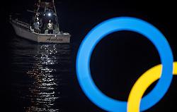 06-08-2016 BRA: Olympic Games day 1, Rio de Janeiro<br /> Madelein Meppelink #2 en Marleen van Iersel #1 hebben de eerste test op de Copacabana goed doorstaan. De Nederlandse beachvolleybalsters wonnen hun poulewedstrijd tegen het koppel Perez Pazo/Agudo Gonzalez zonder problemen: 21-17, 21-11. Een vissersootje houdt het stadion in de gaten.