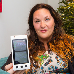 REACH PLC: Olivia Squier with her smart meter at her Camberwell Home in London. LONDON, December 13 2018.