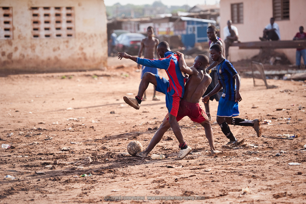 The only school in Avenor, a slum in Ghana's capital Accra, was closed down after inadequate drainage caused it to flood. Young men take advantage of what was once the playground, playing a hard-fought game of street football on a public holiday.