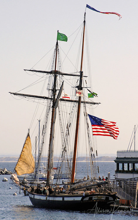 A replica of the Privateer Lynx, a historic topsail schooner visits the wharf of Monterey harbor
