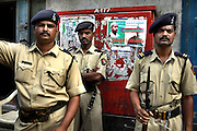 Policemen stand guard outside Narimen House