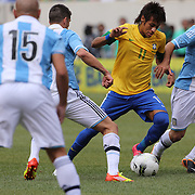 Neymar, Brazil, (left) is challenged by Javier Mascherano, Argentina, during the Brazil V Argentina International Football Friendly match at MetLife Stadium, East Rutherford, New Jersey, USA. 9th June 2012. Photo Tim Clayton