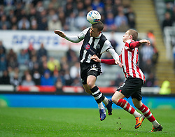 NEWCASTLE, ENGLAND - Sunday, March 4, 2012: Newcastle United's Ryan Taylor in action against Sunderland's James McLean during the Premiership match at St. James' Park. (Pic by David Rawcliffe/Propaganda)