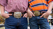 Twins Jacob and David McFarland, 10, from Sylvania, Georgia, show off their belt buckles won at previous shows at the Georgia National Fair in Perry, Georgia, on Saturday, Oct. 8, 2016. Jacob and David are two of four brothers who have raised cows and goats their entire lives. (Photo/Casey Sykes, www.caseysykes.com)