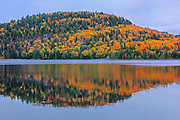 Autumn  colors reflected in Lac Wapizagonke n the Laurentian Mountains. Great Lakes - St.  Lawrence Forest Region.<br />La Mauricie National Park<br />Quebec<br />Canada