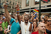 Bystanders cheering New York Governor Andrew Cuomo in the 2011 Pride arade on New York's Fifth Avenue. Cuomo was instrumental in legalizing gay marriage less that 2 days prior to the start of the parade.