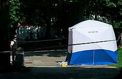 © licensed to London News Pictures. 27/06/2011. London, UK. Police and forensics at the scene of a stabbing in Holloway, London today (27/06/2011) in which a 21 year-old man was killed. The victim was found near to Andover House, in Andover Road on Sunday night (26/06/2011). See special instructions for usage rates. Photo credit should read Simon Lamrock/LNP