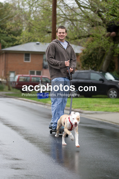05 April 2008: North Carolina Tar Heels defenseman Kerry McCormick (41) with his dog Callie before playing the Virginia Cavaliers in Chapel Hill, NC.