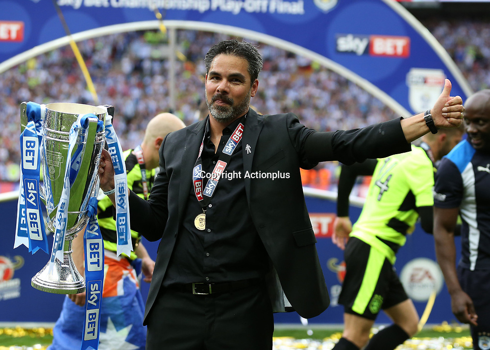 May 29th 2017, Wembley Stadium, London, England; EFL Championship playoff final, Huddersfield Town versus Reading; Huddersfield Town Head Coach David Wagner gives a thumbs up with the EFL Championship playoff final trophy