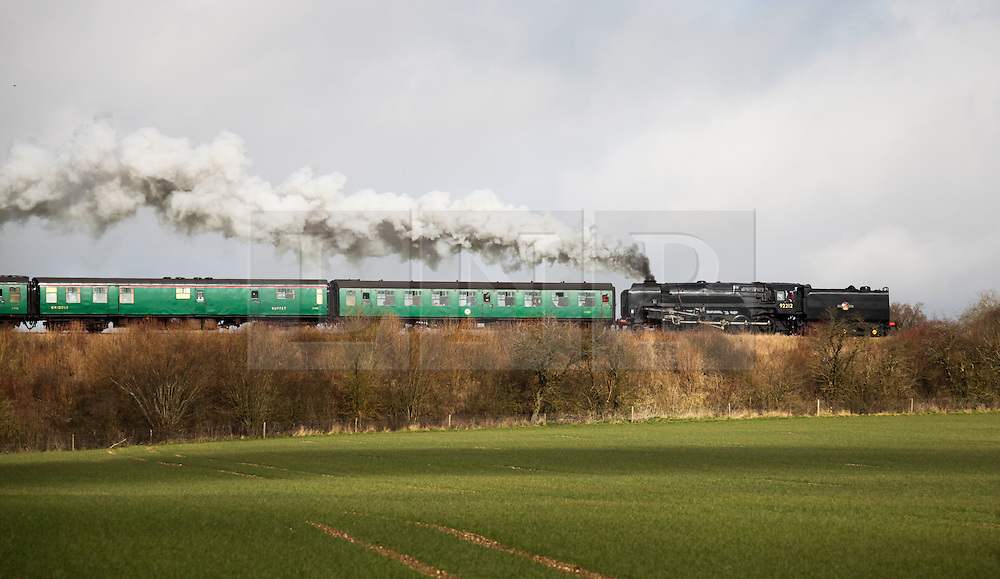 © Licensed to London News Pictures. 07/03/2014. Hampshire, UK. The steam locomotive '92212 - Class 9F' on the Watercress Line today, 7th March 2014, which is the first day of the 'spring steam gala' on the Watercress Line. The railway line, operated by Mid Hants Railway Ltd, passes between Alresford and Alton in Hampshire. The line is named after its use in the past for transporting freshly cut watercress from the beds surrounding Alresford to London. Photo credit : Rob Arnold/LNP