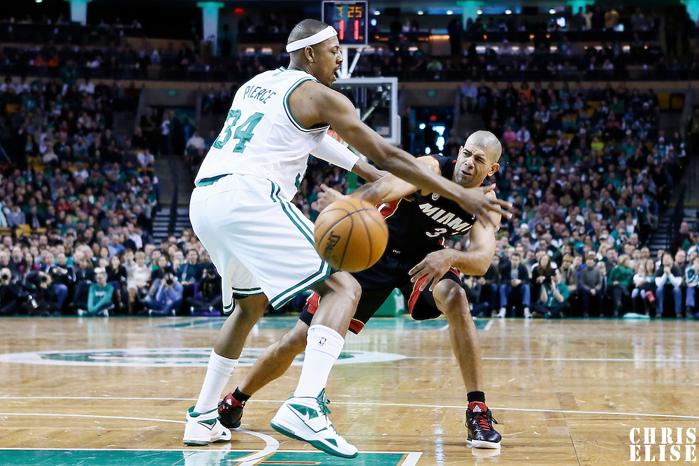 27 January 2013: Miami Heat small forward Shane Battier (31) passes the ball past Boston Celtics small forward Paul Pierce (34) during the Boston Celtics 100-98  2OT victory over the Miami Heat at the TD Garden, Boston, Massachusetts, USA.