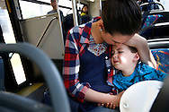 Abby consoles her son Elliott, who was tired after a nap, as they ride the bus to see Abby's boyfriend and Elliott's father, who is currently living in ASAC's adult residential facility in Cedar Rapids on Thursday, May 19, 2016. (Rebecca F. Miller/The Gazette)