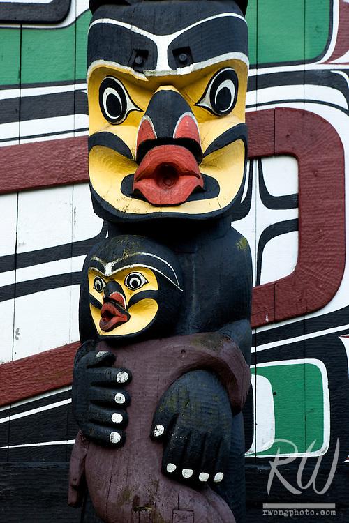 Totem Pole and Kwakwaka'wakw (Kwakiutl) Longhouse in Thunderbird Park, Victoria, B.C.