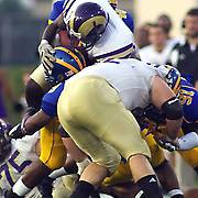 West Chester running back (#28) D'Andre Webb is tackled the first quarter by (#40) Andrew Harrison, (#91) Siddiq Haynes and (#9) Anthony Walters. West Chester trails 0-7. No. 16 Hens would go on to a 31-0 victory in the season opener at Delaware Stadium.....