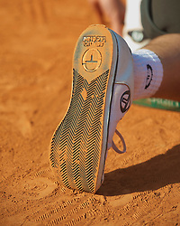 MONTE-CARLO, MONACO - Saturday, April 17, 2010: A ball-boy's shoe covered in clay dust during the Men's Singles Semi-Final on day six of the ATP Masters Series Monte-Carlo at the Monte-Carlo Country Club. (Photo by David Rawcliffe/Propaganda)
