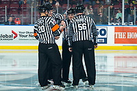 KELOWNA, BC - JANUARY 4:  Referees Chris Crich and Kyle Kowalski and linesmen Dustin Minty and Cody Wanner stand at center ice for a pre game ritual at the Kelowna Rockets against the Vancouver Giants at Prospera Place on January 4, 2020 in Kelowna, Canada. (Photo by Marissa Baecker/Shoot the Breeze)
