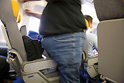 obese person traveling by airplane