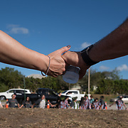 Prayer circle  the day when students and parents came for campus orientation at the Marjory Stoneman Douglas high school for reopening following last week's mass shooting in Parkland, Florida, U.S., February 25, 2018. Attendance was voluntary but hundreds of students and parents showed up. The school opens this coming Wednesday. Seventeen persons including students and staff were murdered in the shooting. REUTERS/Angel Valentin