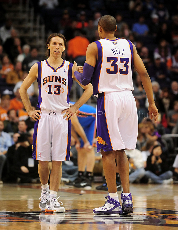 Feb. 4, 2011; Phoenix, AZ, USA; Phoenix Suns guard Steve Nash (13) reacts on the court with teammate forward Grant Hill (33) against the Oklahoma City Thunder at the US Airways Center. The Thunder defeated the Suns 111-107. Mandatory Credit: Jennifer Stewart-US PRESSWIRE.