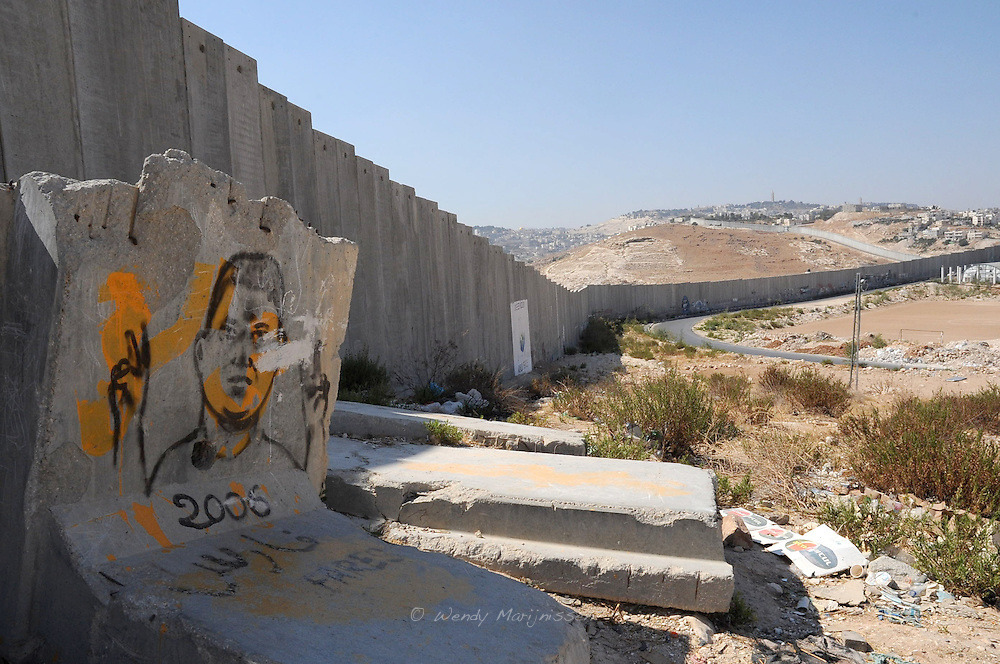 A part of the contested separation wall cutting right through the village Abu Dis. West Bank, Palestine, 2009