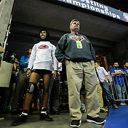 Kris Wilson/News Tribune<br /> Jefferson City head coach Phil Cagle steps out from the tunnel to check out the action on the floor as he waits to accompany Jay wrestler Rashaun Woods to the mat to take on Trey Storey of Blue Springs South in their Class 4 182-pound opening round match during the 2016 MSHSAA Wrestling State Championships at Mizzou Arena in Columbia.