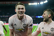 Manchester United Midfielder Scott McTominay celebrates after the whistle in front of fans during the Champions League Round of 16 2nd leg match between Paris Saint-Germain and Manchester United at Parc des Princes, Paris, France on 6 March 2019.