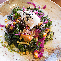A vegan breakfast dish of cauliflower, broccoli, kale, and a poached egg at Three Blue Ducks restaurant in the Bronte Beach neighborhood of Sydney, Australia.