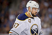 SHOT 3/28/15 7:35:40 PM - The Buffalo Sabres' Zach Bogosian #47 during a break in the action against the Colorado Avalanche in their regular season NHL game at the Pepsi Center in Denver, Co. The Avalanche won the game 5-3. (Photo by Marc Piscotty / © 2015)