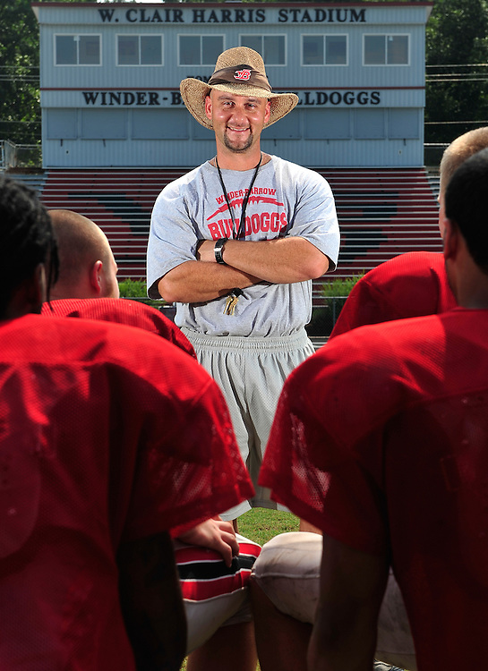 Winder-Barrow High School's new head football coach, David Wagner, poses for a photo at W. Clair Harris Stadium on Tuesday, Aug. 10, 2010 in Winder, Ga. .