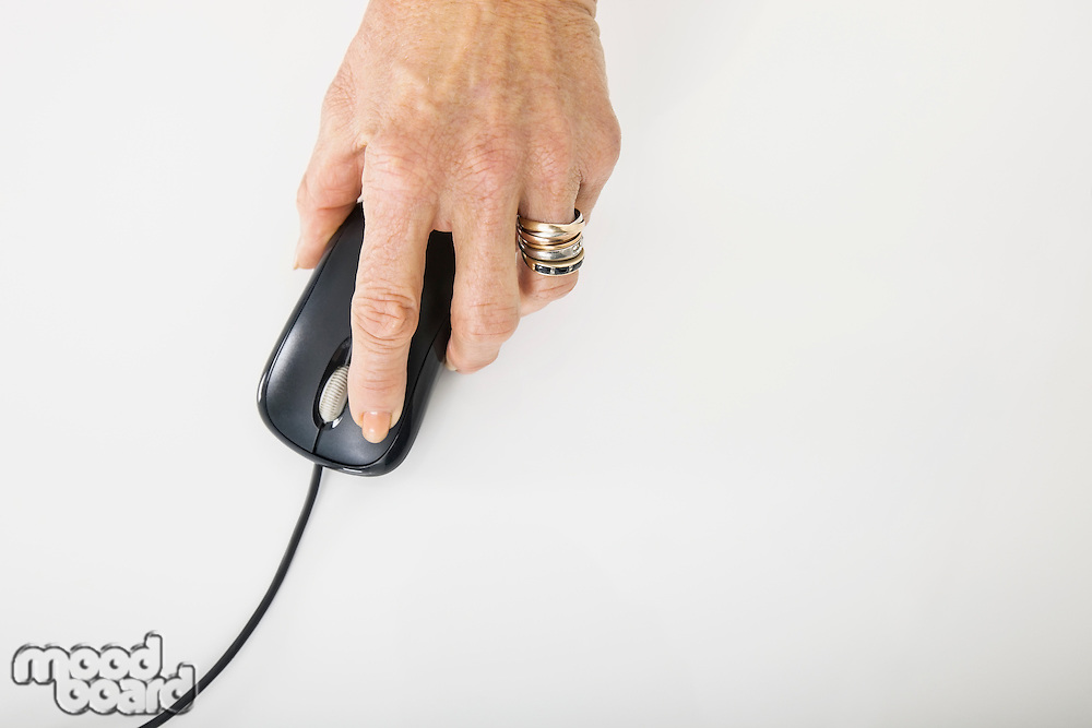 Senior businesswoman's hand using computer mouse