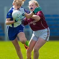 Grace McCusker is tackled by Molly Hogan.<br /> <br /> Lisdoonvarna Parish Schools v Scoil Réalt na Mara, Kilkee/Moyasta NS, in Division 3  Clare Primary Schools Ladies Football Finals at Cusack Park, Ennis, Co. Clare