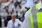 Nederland, NIjmegen, 18-7-2012Een politieman loopt met een schoudercamera, een kleine videocamera die een directe verbinding heeft met de controilekamer.Foto: Flip Franssen/Hollandse Hoogte