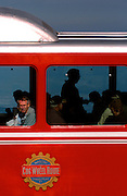 (COLORADO SPRINGS, Co., SHOT 8/17/2004).Passengers reboard the Manitou and Pikes Peak Railway Cog Wheel Route car at the summit of Pike's Peak in the Pike National Forest near Colorado Springs Tuesday on their way back down the mountain. The Cog Wheel Route operates between 6 and 8 trips up and down Pikes Peak every day. Pikes Peak bills itself as the World's Most Visited Mountain. The elevation at the summit is 14,110 feet. The Manitou and Pike's Peak Railway (also known as the Pikes Peak Cog Railway) is an Abt rack system cog railway in Colorado, USA, climbing the well-known mountain Pikes Peak. The base station is in Manitou Springs, Colorado near Colorado Springs. The railway is the highest in North America by a considerable margin and the highest in the northern hemisphere. It was built and is operated solely for the tourist trade..(Photo by MARC PISCOTTY / © 2004)