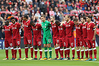 Football - 2017 / 2018 Premier League - Liverpool vs. Crystal Palace<br /> <br /> Liverpool players take part in a minutes silence at Anfield.<br /> <br /> COLORSPORT/LYNNE CAMERON